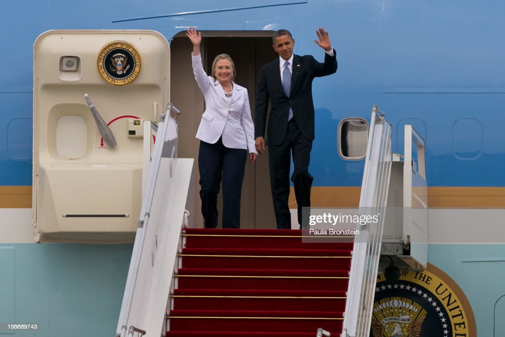 US President Barack Obama and Secretary of State Hillary Clinton wave as they arrive at Yangon International airport during his historical first visit to the country on November 19, 2012 in Yangon, Myanmar. Obama is the first US President to visit Myanmar while on a four-day tour of Southeast Asia that also includes Thailand and Cambodia.