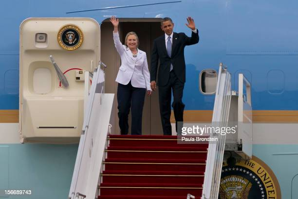 President Barack Obama and Secretary of State Hillary Clinton wave as they arrive at Yangon International airport during his historical first visit...