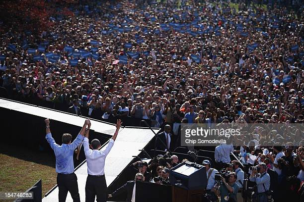 S President Barack Obama and Sen Mark Warner wave to a crowd of about 15000 supporters during a campaign rally at Byrd Park October 25 2012 in...