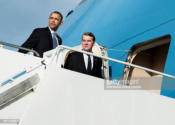 US President Barack Obama and Senator Michael Bennet board Air Force One at Andrews Air Force Base November 6 2013 in Maryland Obama is traveling to...
