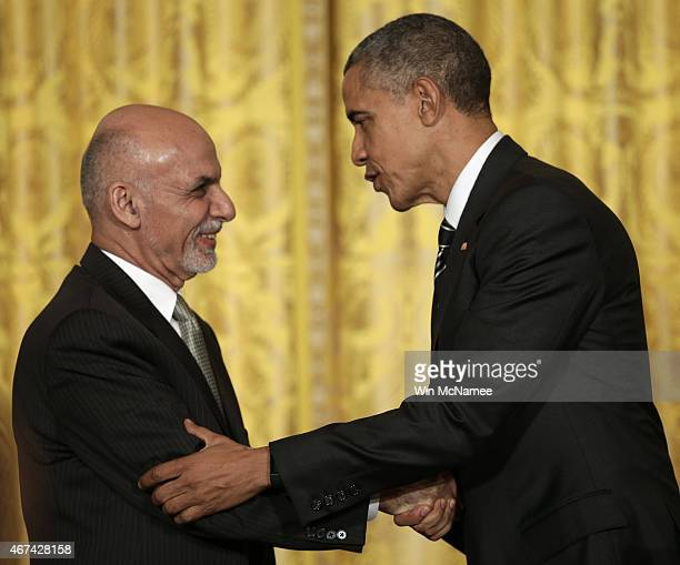 S President Barack Obama and the President of Afghanistan Ashraf Ghani shake hands after holding a joint press conference in the East Room of the...