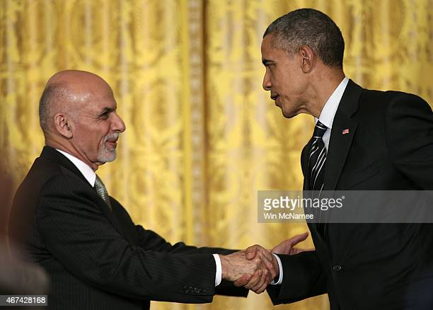 President Barack Obama and the President of Afghanistan Ashraf Ghani shake hands after holding a joint press conference in the East Room of the White...