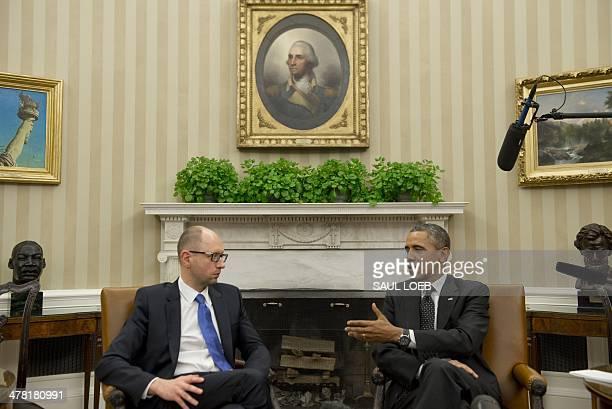US President Barack Obama and Ukrainian Prime Minister Arseniy Yatsenyuk speak during meetings in the Oval Office of the White House in Washington DC...