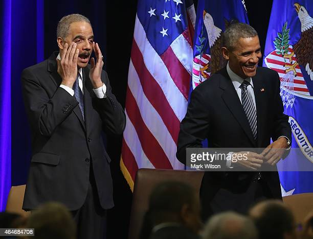 President Barack Obama and US Attorney General Eric Holder react at the introduction of singer Aretha Franklin who sung during a farwell ceremony at...