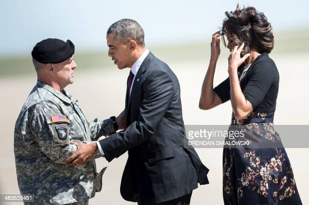 US President Barack Obama and US first lady Michelle Obama are greeted Army Lt General Mark Milley commanding officer of Fort Hood after arriving at...