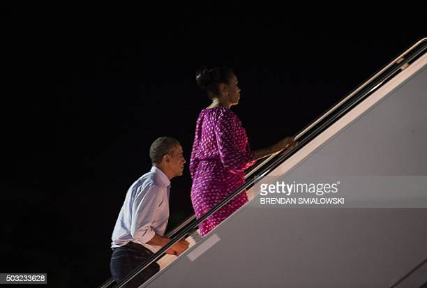 US President Barack Obama and US first lady Michelle Obama board Air Force One at Joint Base Pearl HarborHickam in Honolulu Hawaii on January 2 2016...