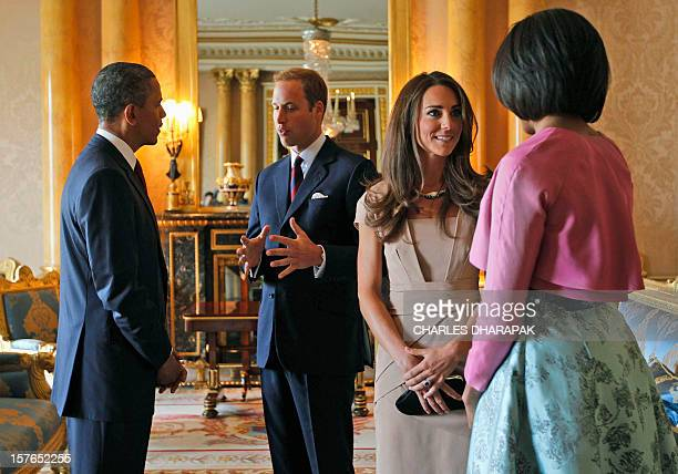 President Barack Obama and US First Lady Michelle Obama meet Britain's Prince William the Duke of Cambridge and his wife Catherine Duchess of...