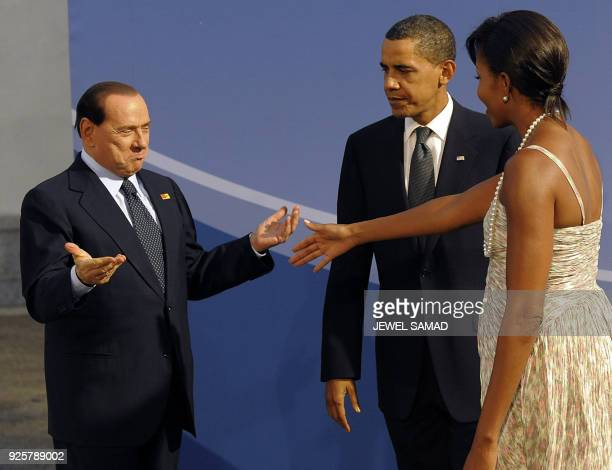US President Barack Obama and US First Lady Michelle Obama welcome Italian Prime Minister Silvio Berlusconi to the G20 dinner on September 24 2009 in...