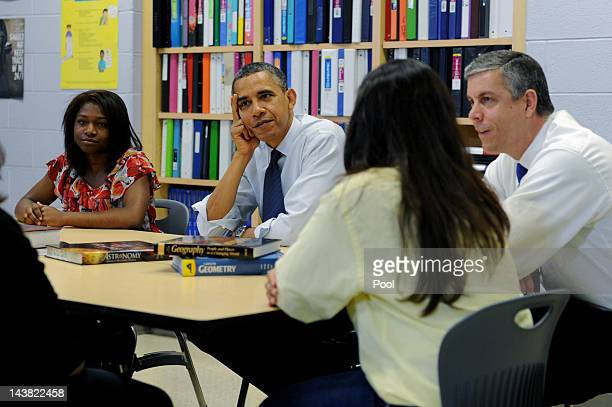 S President Barack Obama and US Secretary of Education Arne Duncan participate in a roundtable discussion about higher education with high school...
