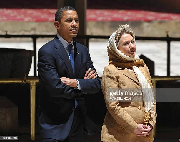 US President Barack Obama and US Secretary of State Hillary Clinton tour the Sultan Hassan Mosque June 4 2009 in Cairo Built in 1256 the mosque is...
