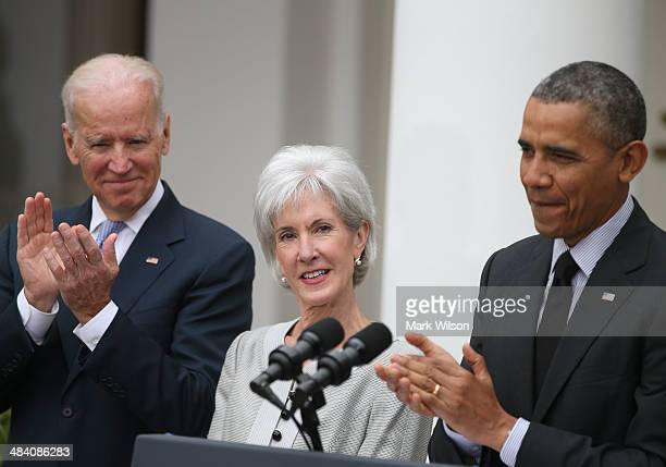 S President Barack Obama and US Vice President Joe Biden applaud outgoing Health and Human Services Secretary Kathleen Sebelius during an event in...