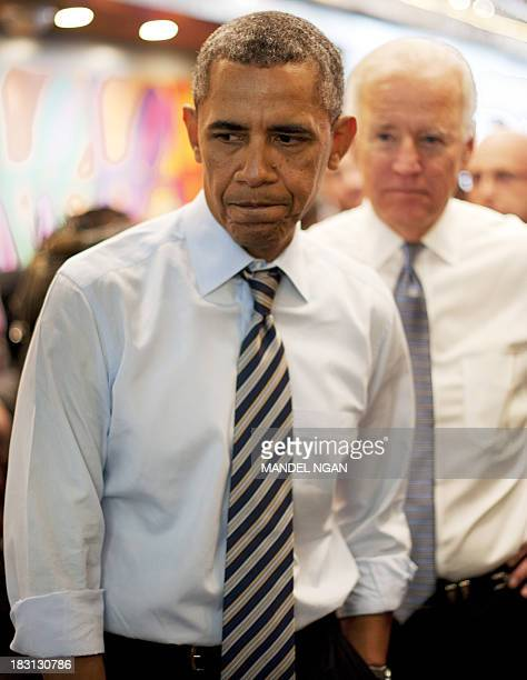 President Barack Obama and US Vice President Joe Biden arrive to order lunch to go at Taylor Gourmet Deli on Pennsylvania Ave in Washington DC on...