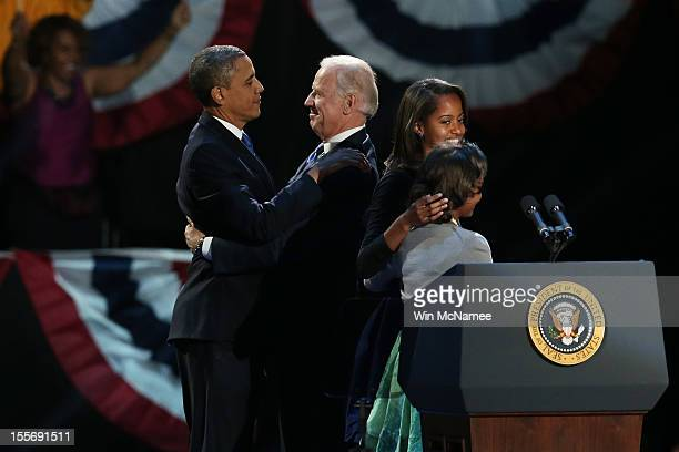 S President Barack Obama and US Vice President Joe Biden embrace on stage with family after his victory speech on election night at McCormick Place...