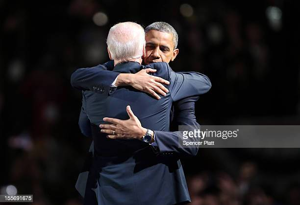 S President Barack Obama and US Vice President Joe Biden embrace on stage after his victory speech on election night at McCormick Place November 6...