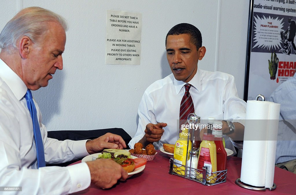 U.S. President Barack Obama (R) and U.S. Vice President Joe Biden sit at a table with their cheeseburger lunch orders at Ray's Hell Burger May 5, 2009 in Arlington, Virginia. Obama and Biden made an unannouced vist to the Arlington restaurant.
