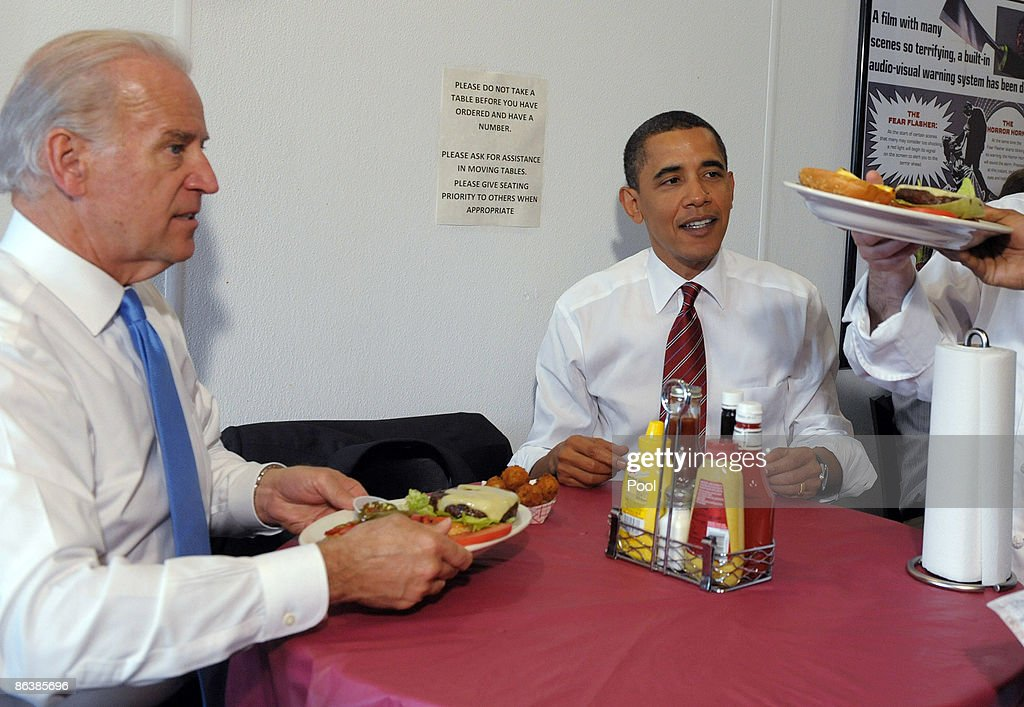 U.S. President Barack Obama (C) and U.S. Vice President Joe Biden (L) sit at a table as they are served their cheeseburger lunch orders at Ray's Hell Burger May 5, 2009 in Arlington, Virginia. Obama and Biden made an unannouced vist to the Arlington restaurant.