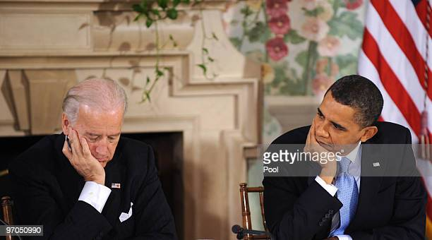 S President Barack Obama and US Vice President Joseph Biden listen to a speaker during a bipartisan meeting to discuss health reform legislation with...