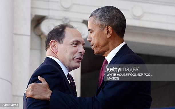 US President Barack Obama and Veterans Affair secretary Robert McDonald attend a ceremony at Arlington National Cemetery November 11 2015 in...