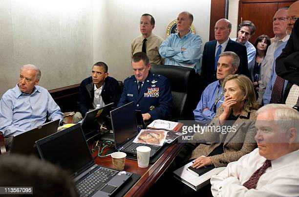 President Barack Obama and Vice President Joe Biden, along with with members of the national security team, receive an update on the mission against...