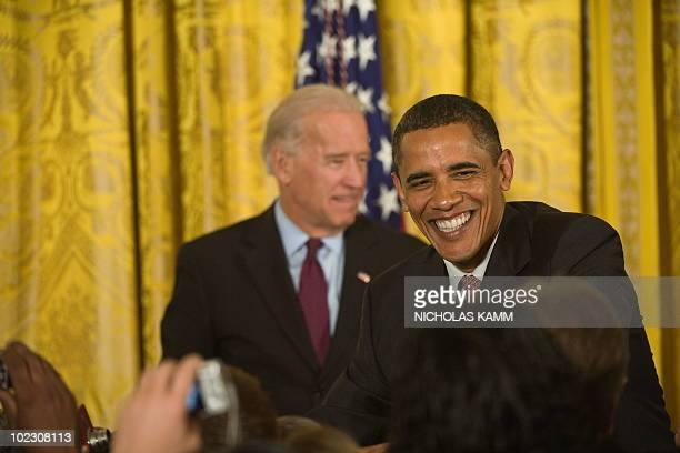 US President Barack Obama and vice president Joe Biden greet attendees before speaking at a Lesbian Gay Bisexual and Transgender Pride Month event in...