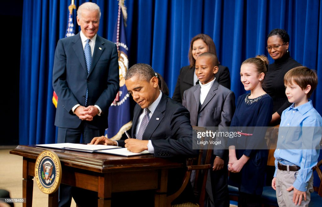 President Barack Obama and Vice President Joe Biden join children who wrote letters to the White House expressing concern about gun violence before President Obama signs executive orders designed to reduce gun violence in the United States in the Eisenhower Executive Building on January 16, 2013 in Washington, DC.