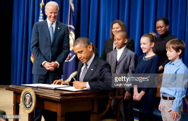 President Barack Obama and Vice President Joe Biden join children who wrote letters to the White House expressing concern about gun violence before...