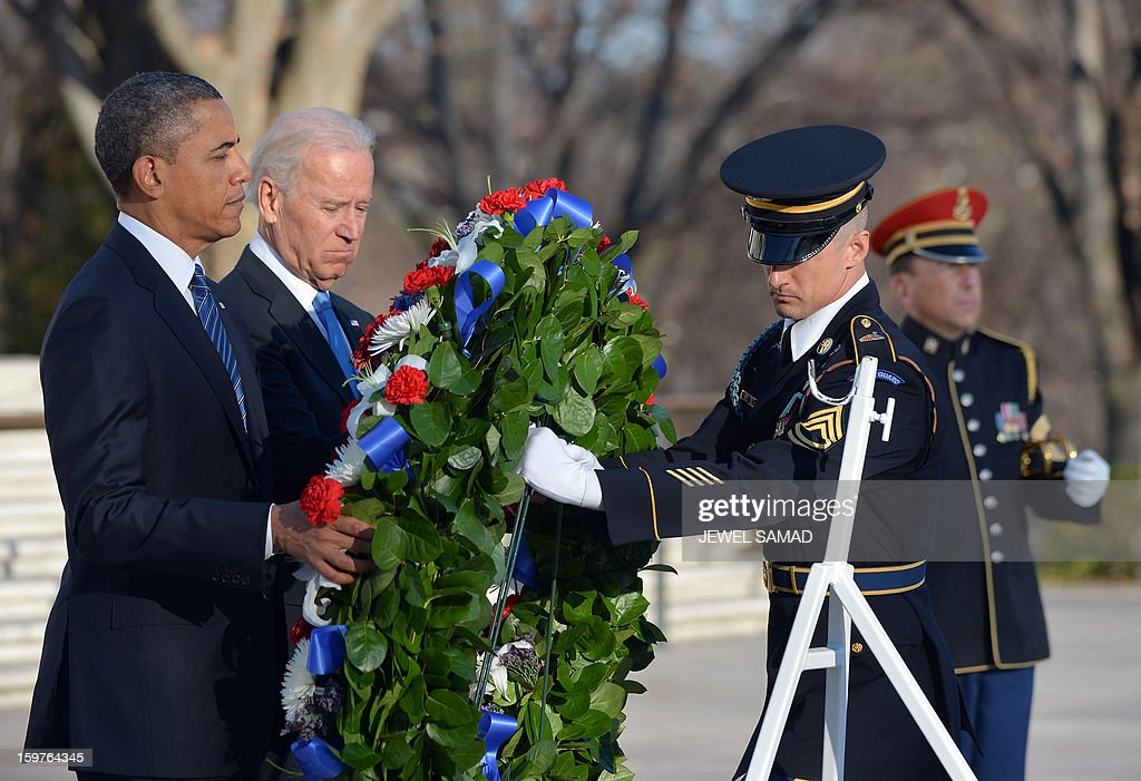 US President Barack Obama and Vice President Joe Biden lay a wreath at the Tomb of the Unknowns at Arlington National Cemetery in Arlington, Virginia, on January 20, 2013. Obama will be officially sworn in for a second term in office later in the day. AFP PHOTO/Jewel Samad