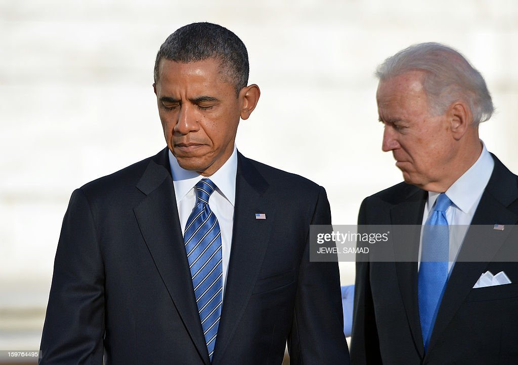 US President Barack Obama and Vice President Joe Biden leave after laying a wreath at the Tomb of the Unknowns at Arlington National Cemetery in Arlington, Virginia, on January 20, 2013. Obama and Biden will be officially sworn in for a second term in office later in the day. AFP PHOTO/Jewel Samad