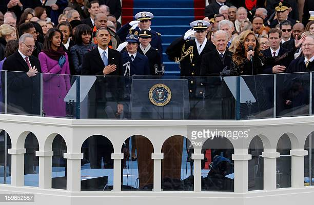 US President Barack Obama and Vice President Joe Biden listen as singer Beyonce sings the national anthem at the ceremonial swearingin during the...