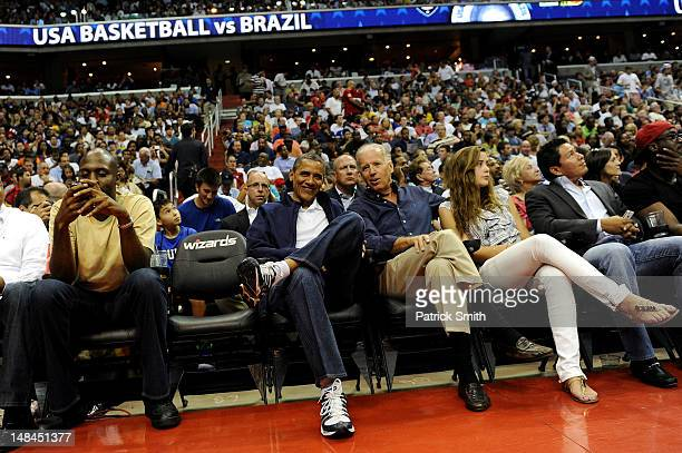 President Barack Obama and Vice President Joe Biden look on as the US Senior Men's National Team and Brazil play during a pre-Olympic exhibition...