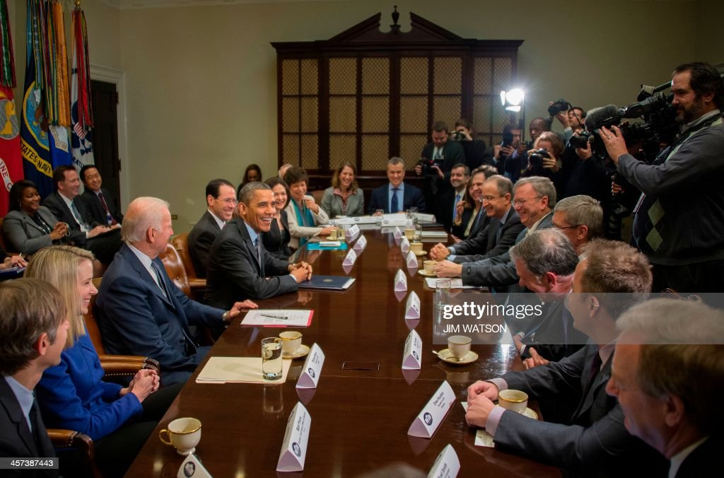 US President Barack Obama (4th L) and Vice President Joe Biden (3rd L) meet with executives from leading tech companies to discuss progress with HealthCare.gov at the White House in Washington, DC, December 17, 2013. Attending the meeting were Tim Cook, CEO, Apple; Dick Costolo, CEO, Twitter; Chad Dickerson, CEO, Etsy; Reed Hastings, Co-Founder & CEO, Netflix; Drew Houston, Founder & CEO, Dropbox; Marissa Mayer, President and CEO, Yahoo!; Burke Norton, Chief Legal Officer, Salesforce; Mark Pincus, Founder, Chief Product Officer & Chairman, Zynga; Shervin Pishevar, Co-Founder & Co-CEO, Sherpa Global; Brian Roberts, Chairman & CEO, Comcast; Erika Rottenberg, Vice President, General Counsel and Secretary, LinkedIn; Sheryl Sandberg, COO, Facebook; Eric Schmidt, Executive Chairman, Google; Brad Smith, Executive Vice President and General Counsel, Microsoft; and Randall Stephenson, Chairman & CEO, AT&T. AFP PHOTO / Jim WATSON
