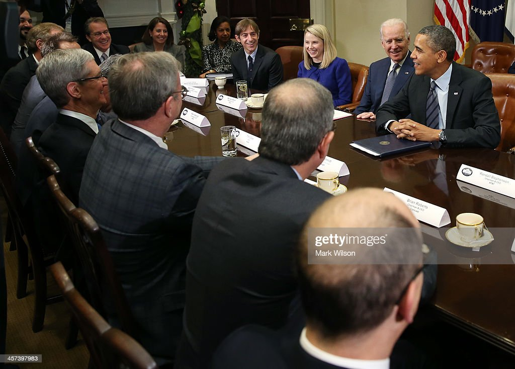 U.S. President Barack Obama (R) and Vice President Joe Biden (2R) meet with executives from leading technology companies, including Apple, Twitter, and Google in the Roosevelt Room of the White House on December 17, 2913 in Washington, DC. The White House said the meeting focused on efforts to repair administration's troubled HealthCare.gov website.