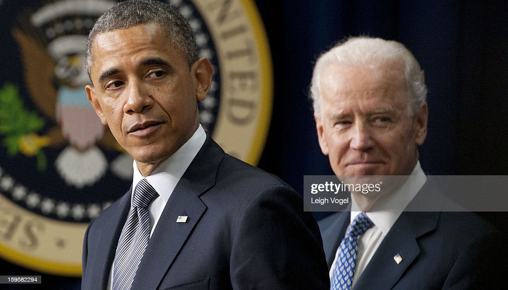 President Barack Obama and Vice President Joe Biden speak before President Obama signs executive orders designed to reduce gun violence in the United States in the Eisenhower Executive Building on January 16, 2013 in Washington, DC.