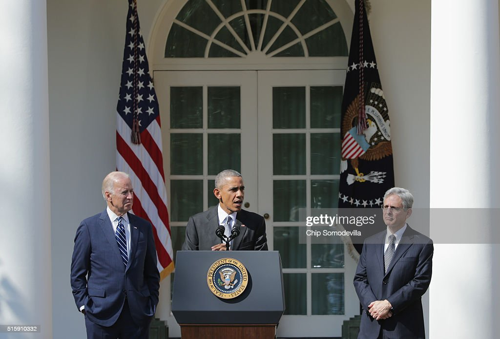 U.S. President Barack Obama (C) and Vice President Joe Biden (L) stands with Judge Merrick B. Garland (R), while nominating him to the US Supreme Court, in the Rose Garden at the White House, March 16, 2016 in Washington, DC. Merrick currently serves on the United States Court of Appeals for the District of Columbia Circuit, and if confirmed by the US Senate, would replace Antonin Scalia who died suddenly last month.