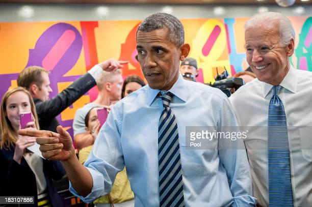 S President Barack Obama and Vice President Joe Biden talk to the media at Taylor Gourmet on Pennsylvania Avenue after walking from the White House...