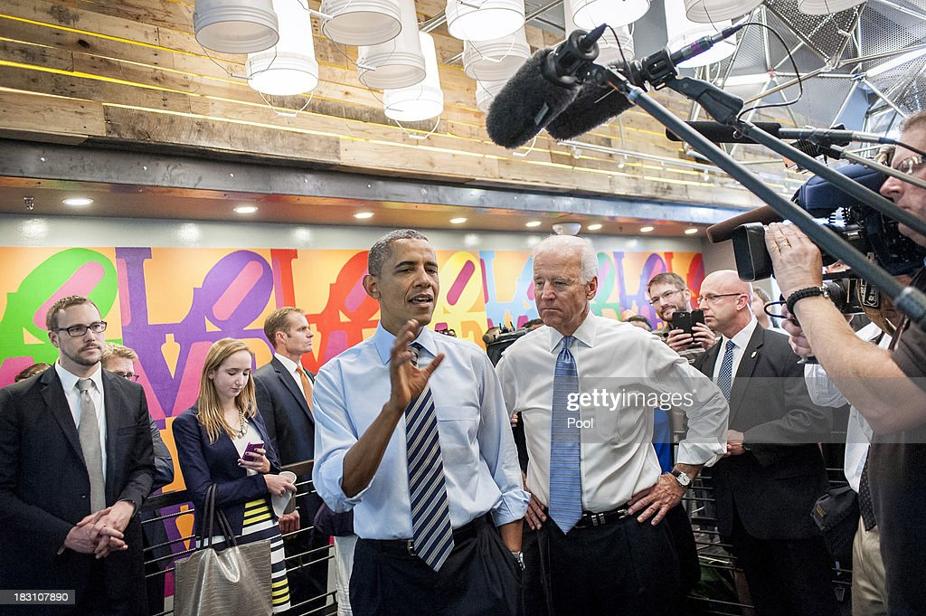 U.S. President Barack Obama (L) and Vice President Joe Biden talk to the media at Taylor Gourmet on Pennsylvania Avenue after walking from the White House for a take-out lunch October 4, 2013 in Washington, DC. Democrats and Republicans are still at a stalemate on funding for the federal government as the shutdown goes into the fourth day. The deli, like many other eateries in Washington, is currently offering a discount for furloughed federal workers.