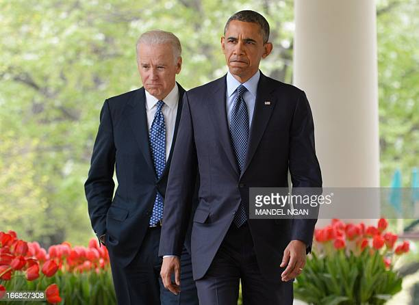 US President Barack Obama and Vice President Joe Biden walk through the Colonnade to deliver remarks on gun control on April 17 2013 in the Rose...