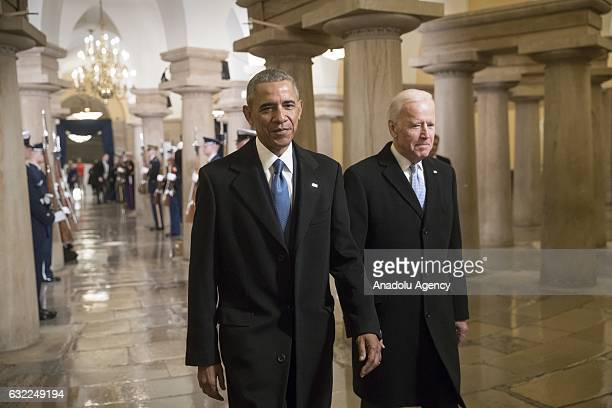 President Barack Obama and Vice President Joe Biden walk through the Crypt of the Capitol for Donald Trumps inauguration ceremony in Washington USA...