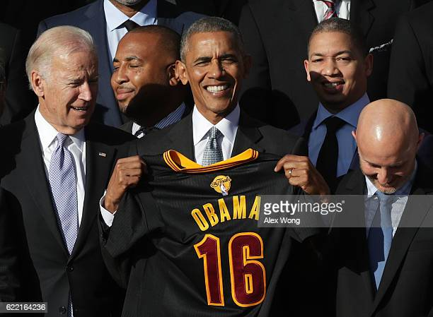 President Barack Obama and Vice President Joseph Biden pose for photos with head coach Tyronn Lue and other members of the Cleveland Cavaliers during...
