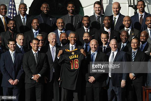 S President Barack Obama and Vice President Joseph Biden pose for photos with members of the Cleveland Cavaliers during a South Lawn event November...