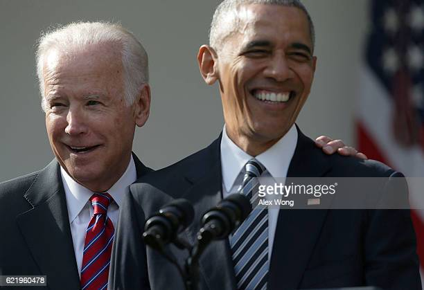 S President Barack Obama and Vice President Joseph Biden share a moment during a statement about the election in the Rose Garden at the White House...