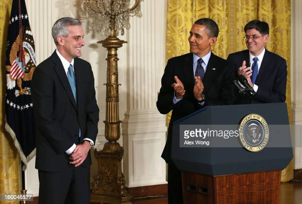 S President Barack Obama and White House Chief of Staff Jack Lew applaud as Deputy National Security Adviser Denis McDonough look on during a...