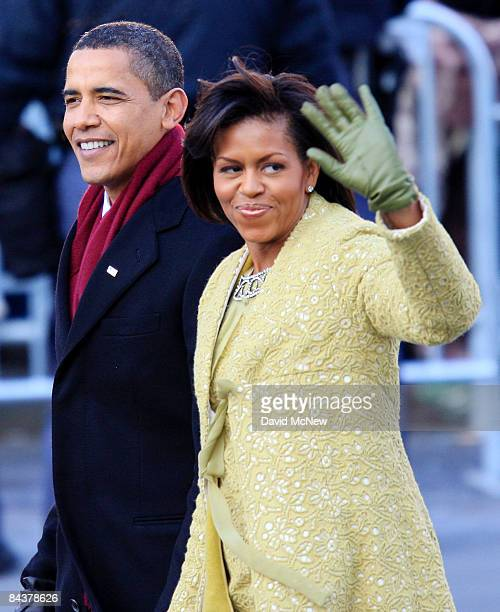 President Barack Obama and wife Michelle Obama walk in the inaugural parade on January 20 2009 in Washington DC Obama was sworn in as the 44th...