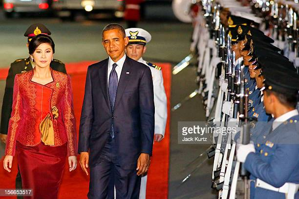 President Barack Obama and Yingluck Shinawatra Prime Minister of Thailand review Thai troops during a welcoming ceremony for President Obama outside...