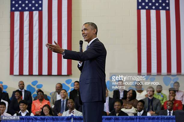 US President Barack Obama announces new commitments in support of the My Brother's Keeper initiative at the Walker Jones Education Center in...