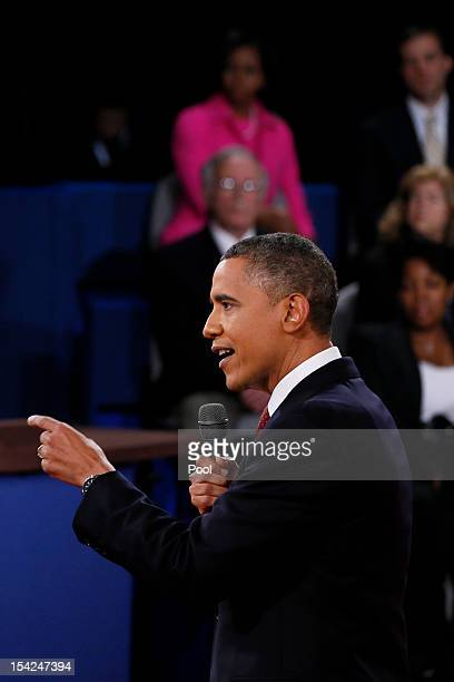 S President Barack Obama answers a question as moderator Candy Crowley looks on during a town hall style debate at Hofstra University October 16 2012...