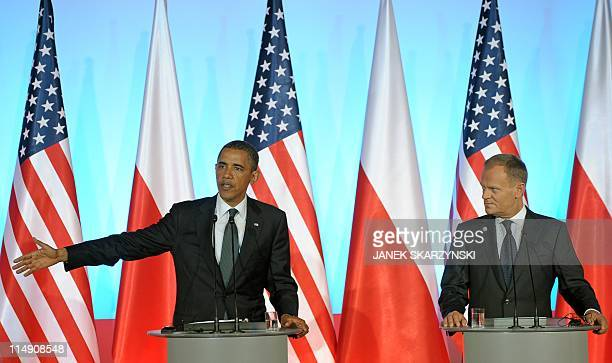 US President Barack Obama answers a question as Polish Prime Minister Donald Tusk watches during a joint press conference following their meeting at...