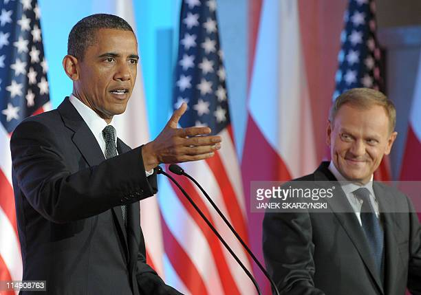 US President Barack Obama answers a question as Polish Prime Minister Donald Tusk looks on during a joint press conference following their meeting at...
