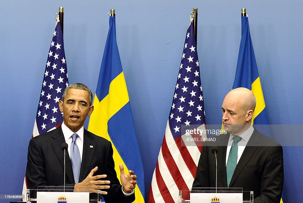 US President Barack Obama (L) answers a question as Swedish Prime Minister Fredrik Reinfeldt looks on during a joint press conference after their bilateral meeting at the Rosenbad Building in Stockholm on September 4, 2013. Obama met with Fredrik Reinfeldt upon arrival in Sweden on a two-day official trip before leaving for Russia, where he will attend G20 summit. Russia on Thursday hosts the G20 summit hoping to push forward an agenda to stimulate growth but with world leaders distracted by divisions on the prospect of US-led military action in Syria.