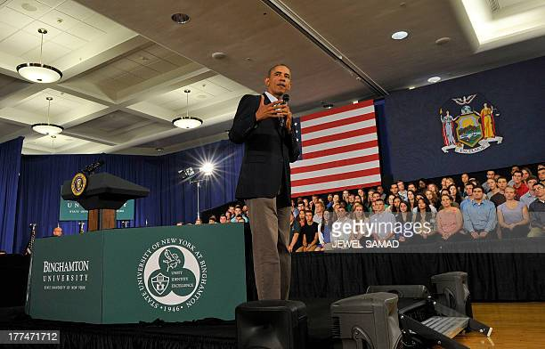 US President Barack Obama answers a question during a town hall meeting at Binghamton University on August 23 2013 in Binghamton New York Obama is on...